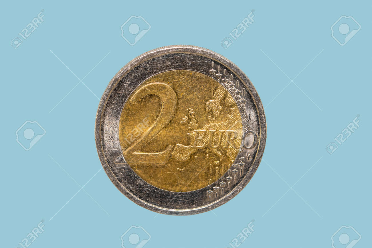 Close up shot of old Two Euro coin against blue background - 163199834
