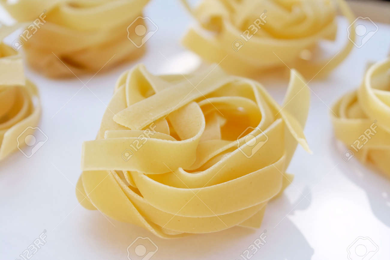 Italian traditional pasta tagliatelle made with flour and eggs. Stock Photo - 590892
