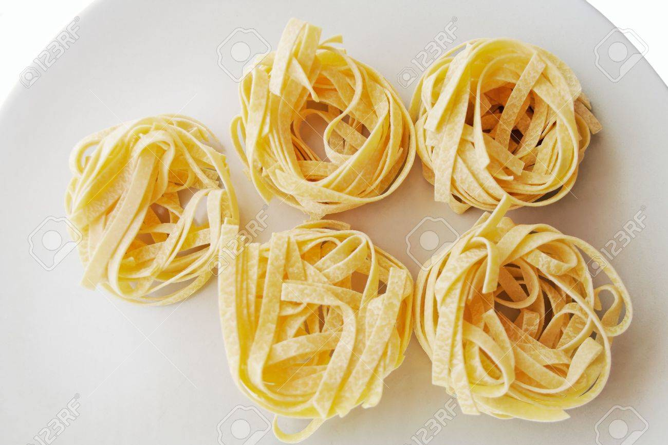 Italian traditional pasta tagliatelle made with flour and eggs. Stock Photo - 590891