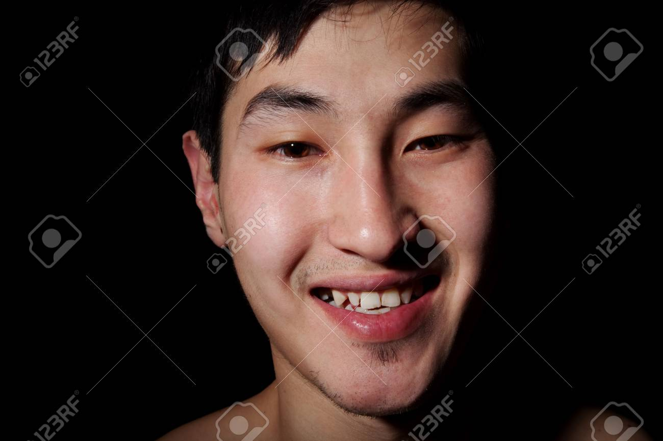 The obverse portrait of the young Asian man which smiles Stock Photo - 6596305