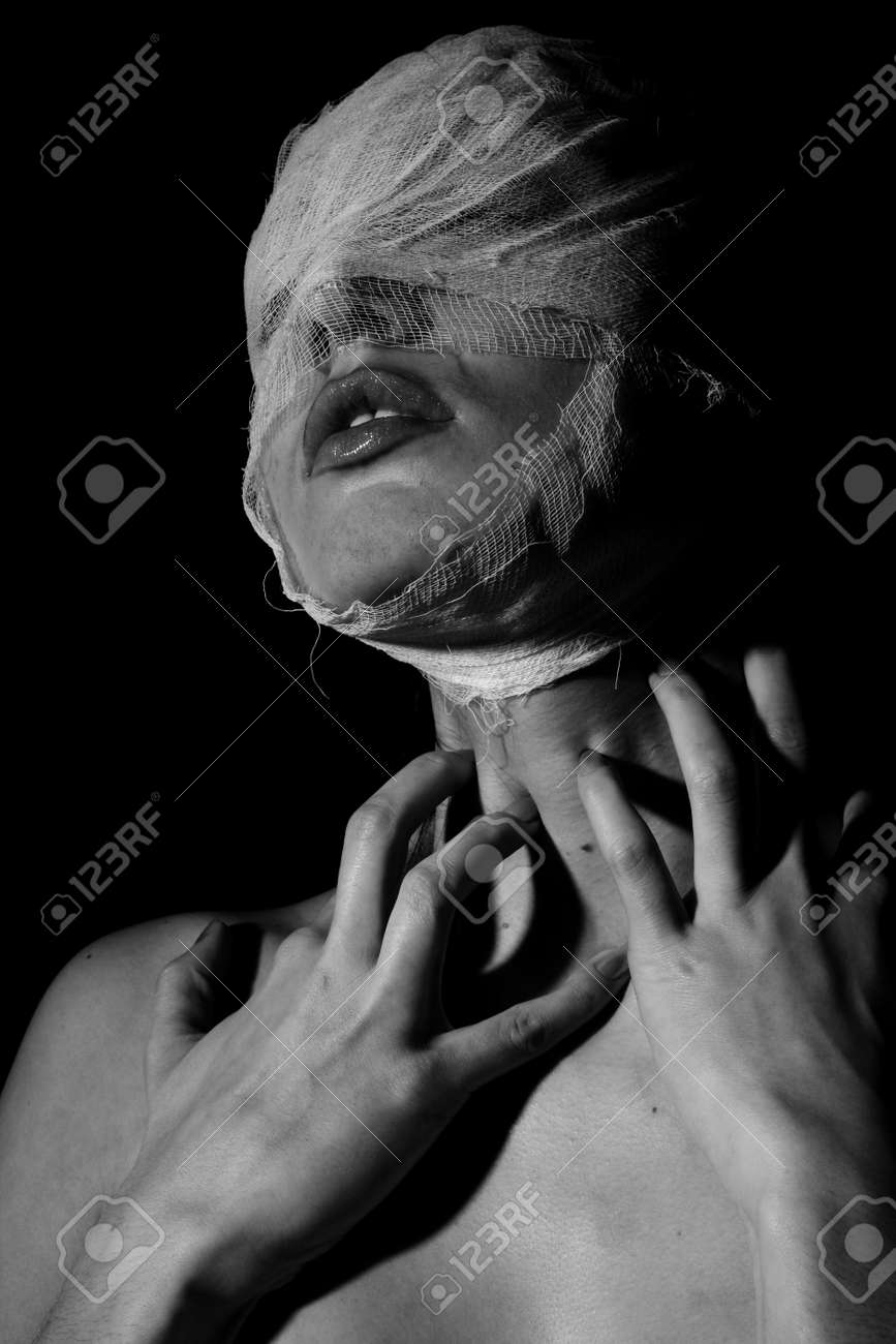 Stock photo the bared girl wound with bandage emotional portraits on a black background