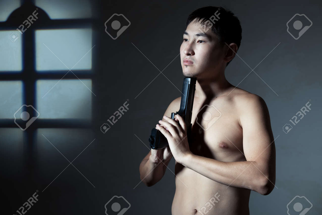 The guy with a pistol aims to itself in in a chin Stock Photo - 16334719
