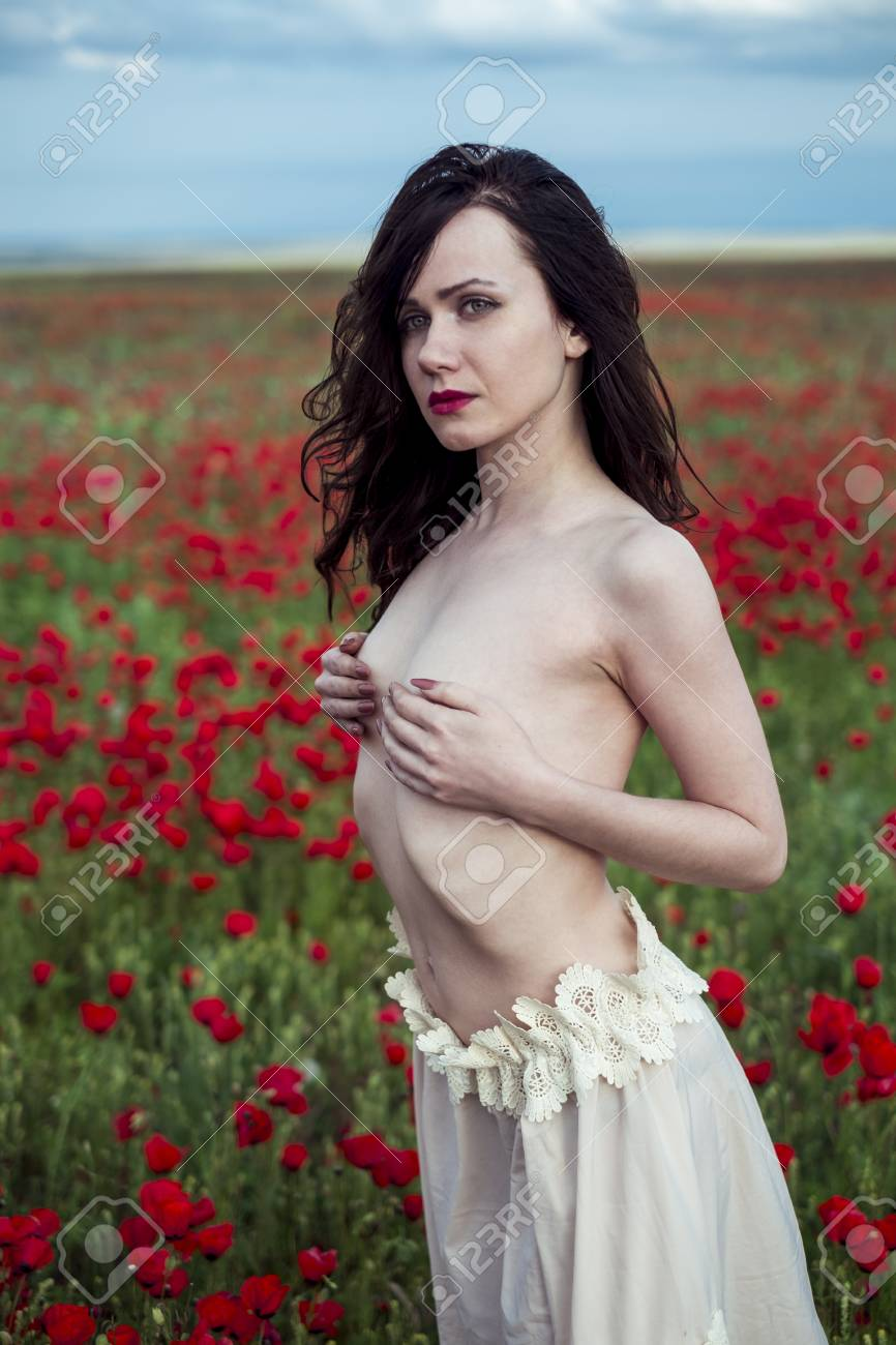 the seminude girl poses on a poppy field stock photo picture and