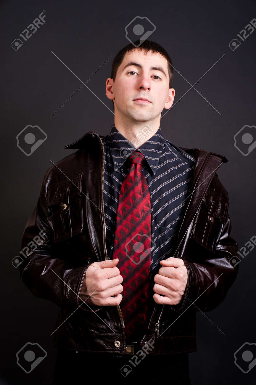 c58ca85acda5 Young Man In Black Shirt And Red Tie Stock Photo, Picture And ...