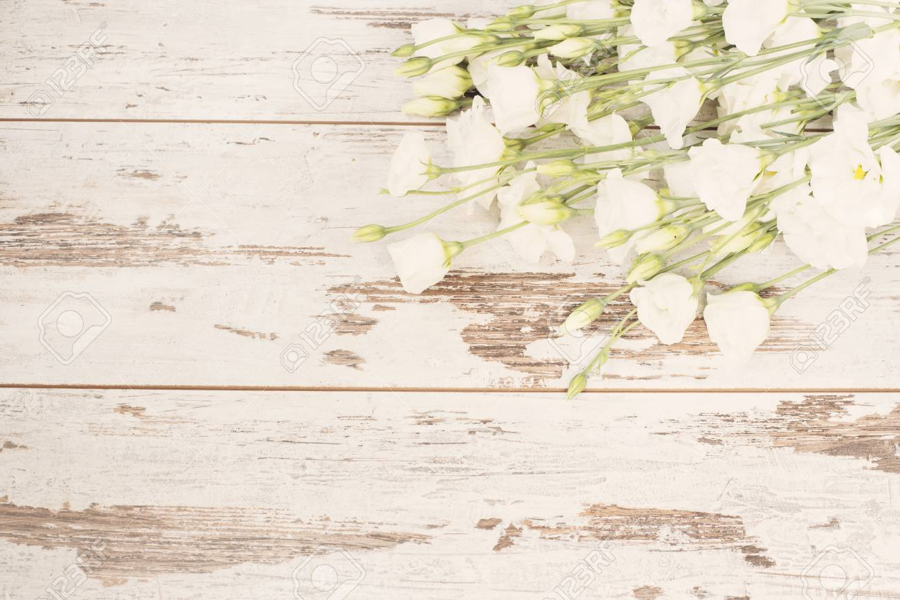 Stunning Fresh Bouquet Of White Flowers On Light Rustic Wooden