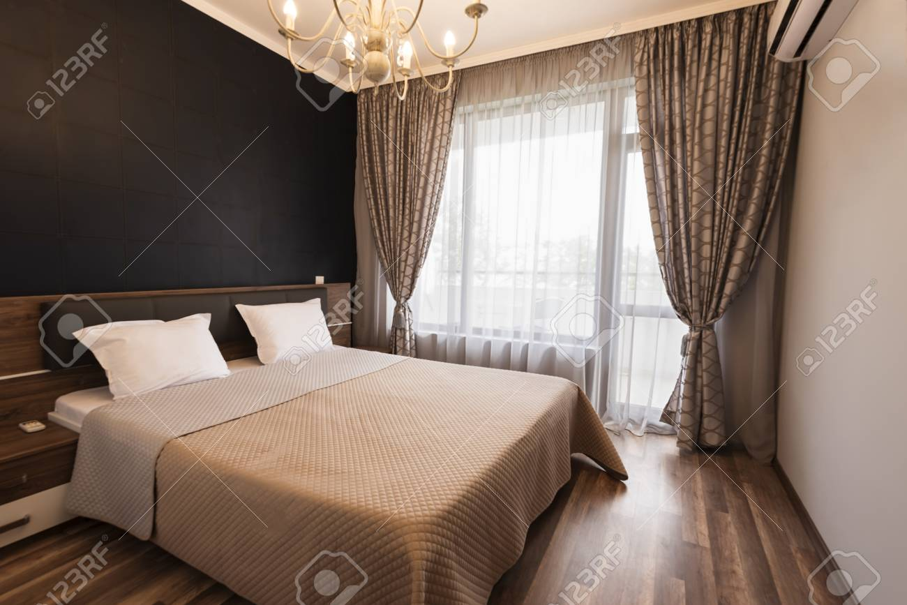 Modern bedroom interior design. Luxury bed room with brown color..