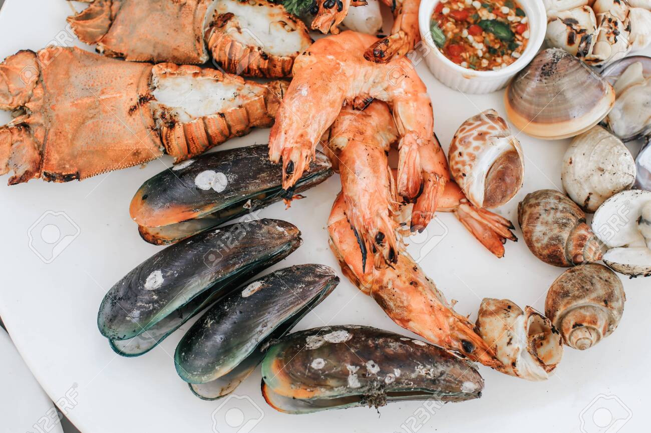 Close Up Of Delicious Grilled Seafood Platter Tray Of Mussel Stock Photo Picture And Royalty Free Image Image 139353592