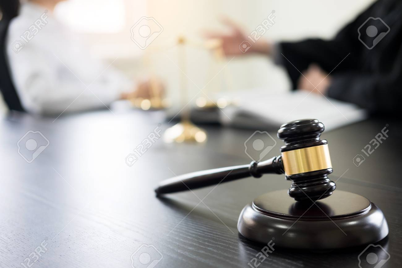 Judge gavel with lawyers advice legal at law firm in background. Concepts of law, services. - 88297338