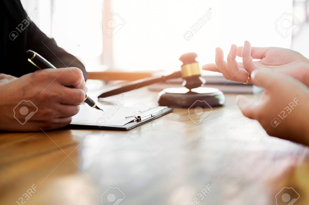 business people and lawyers discussing contract papers sitting at the table. Concepts of law, advice, legal services. - 88413269