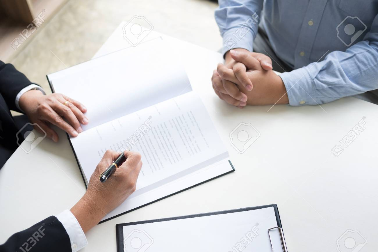 business people and lawyers discussing contract papers sitting at the table. Concepts of law, advice, legal services. - 90070381
