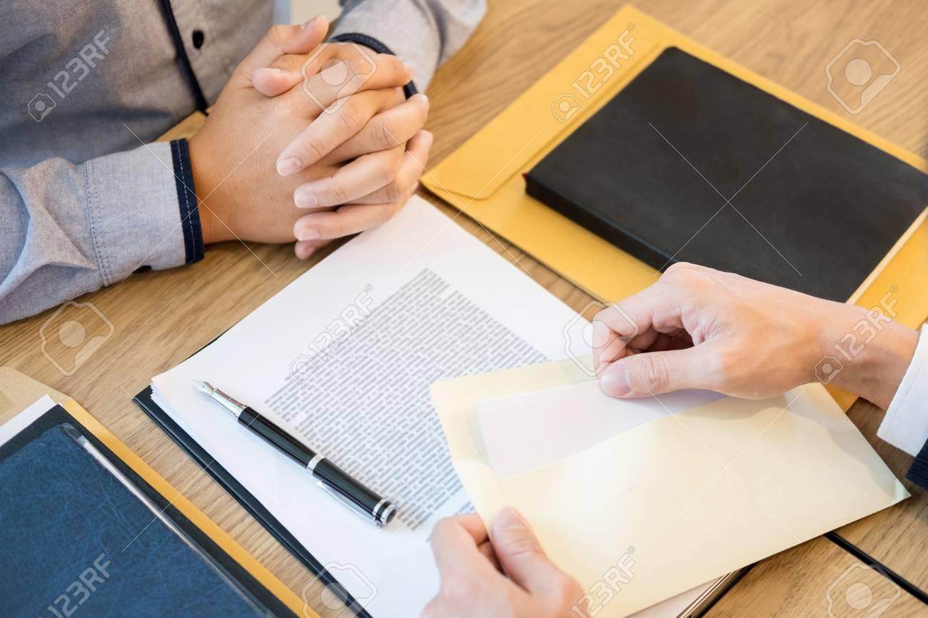 Businessman Hand Sending A Resignation Letter To Executive Boss