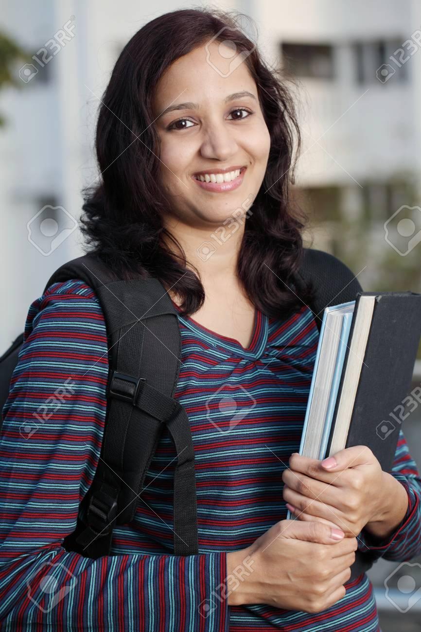 Smiling Indian female student holding books Stock Photo - 27216926