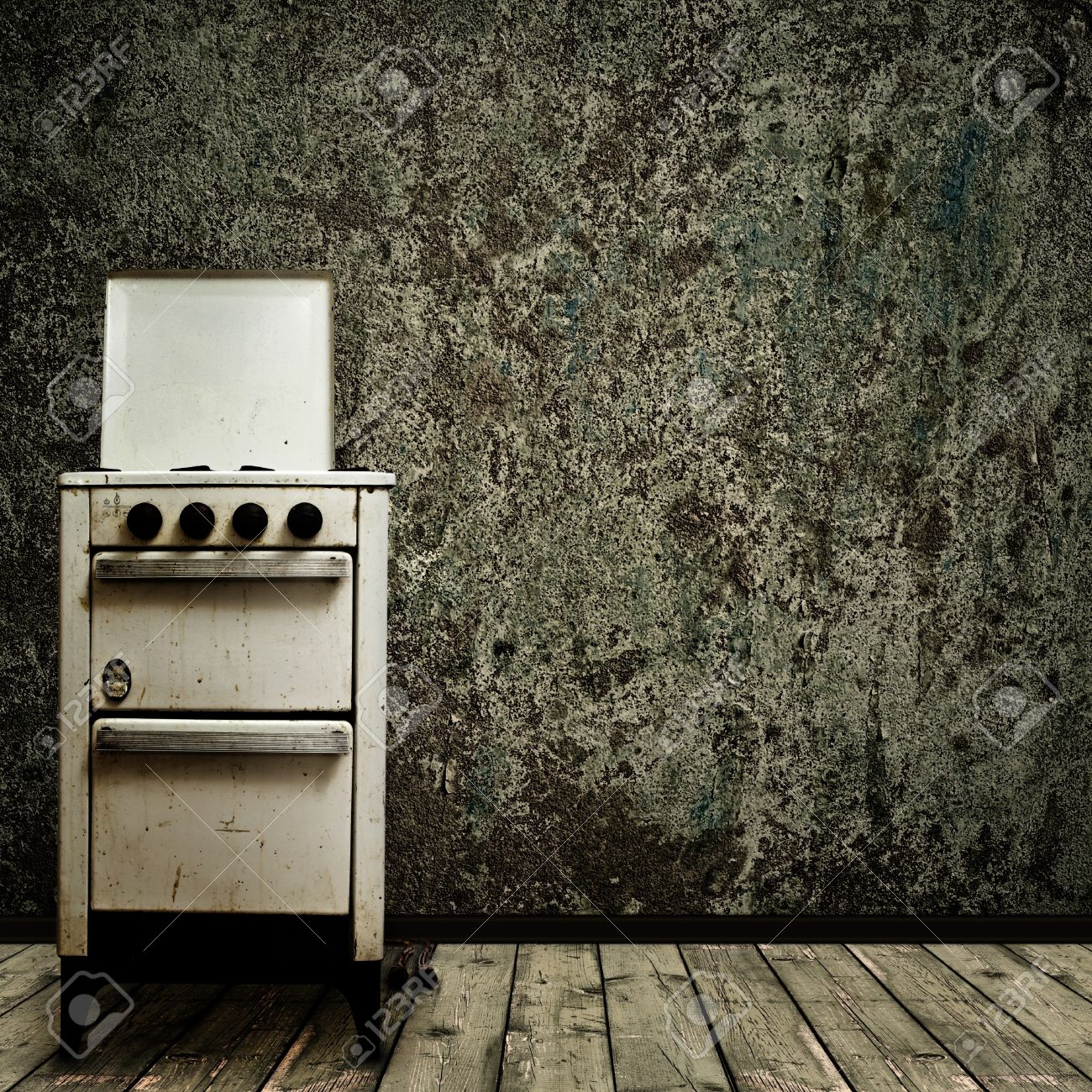 Kitchen Wall Background old gas stove over the grunge wall background stock photo, picture