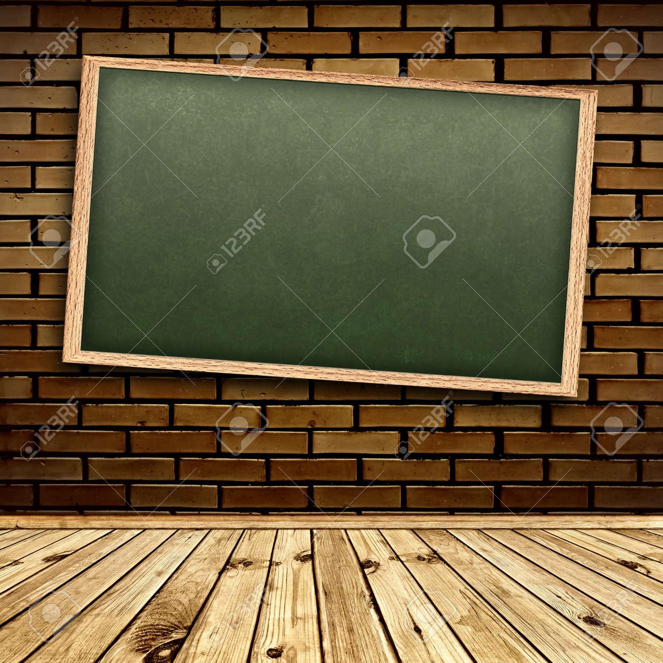 Empty school blackboard at brick wall in interior with wooden floor Stock Photo - 7303345