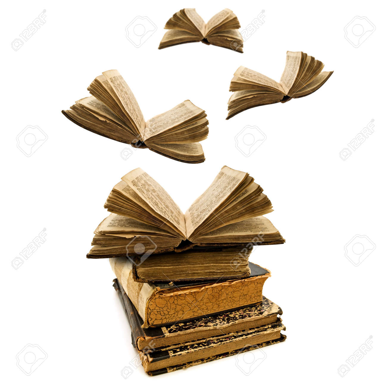 education concept: opened old books flying away Stock Photo - 7446657