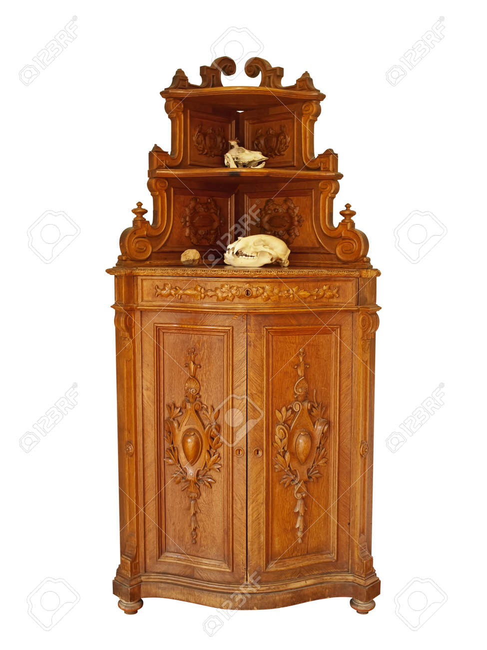 Old cupboard with animals skulls against white background Stock Photo - 10418392