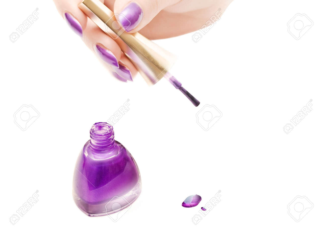 manicure: nail polish and woman hand over white background with copyspace Stock Photo - 11243286