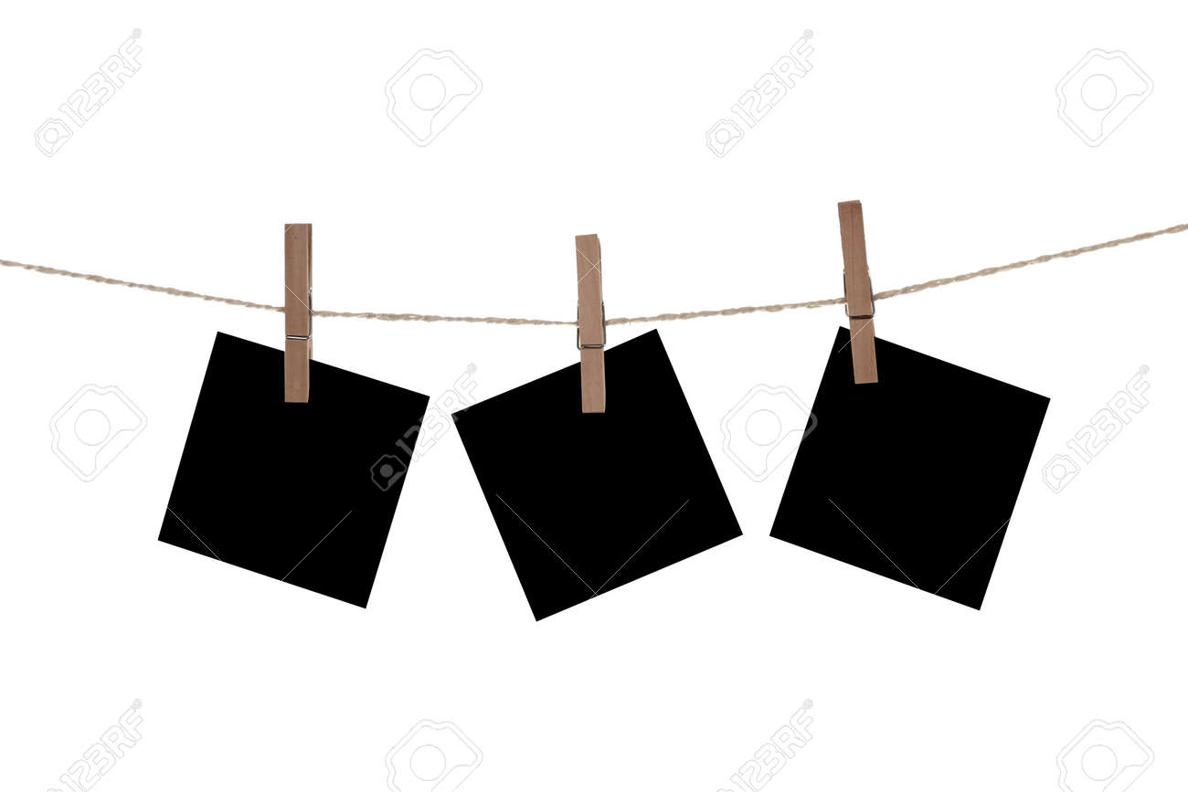 Blank paper cards hanging on clothespins Stock Photo - 17938118