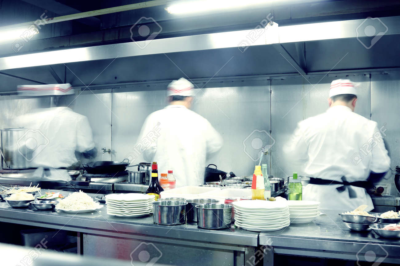 Busy Restaurant Kitchen motion chefs of a restaurant kitchen stock photo, picture and