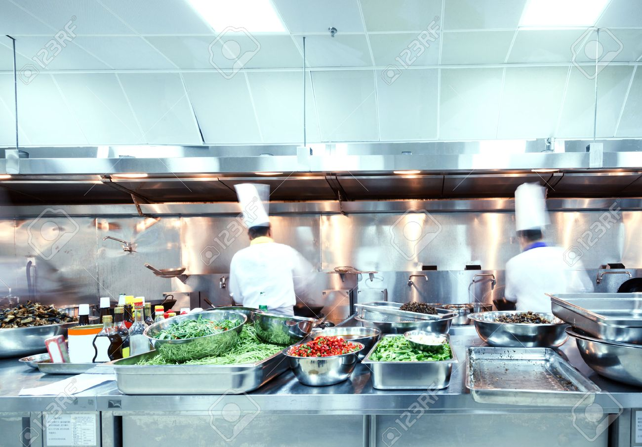 Motion Chefs Of A Restaurant Kitchen Stock Photo, Picture And ...