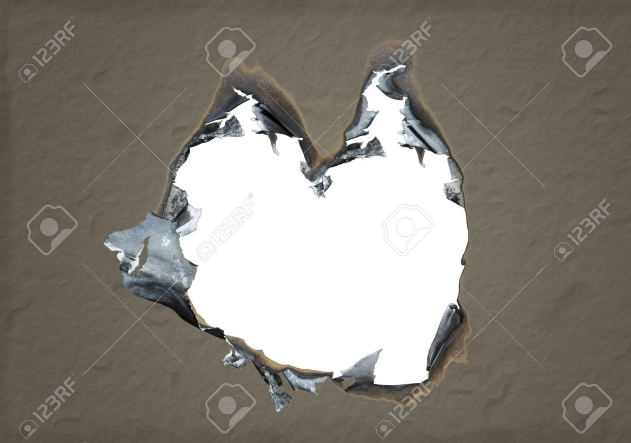 Corazón En Forma De Agujero Quemado En Papel. Aislado Espacio En ...
