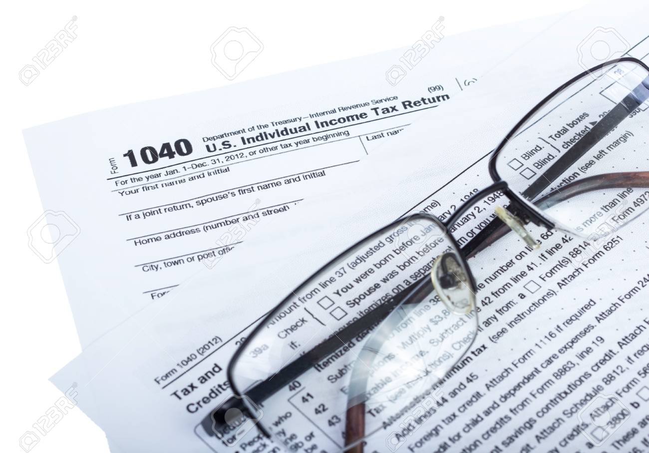 American federal tax form 1040 isolated on white stock photo american federal tax form 1040 isolated on white stock photo 20154042 falaconquin