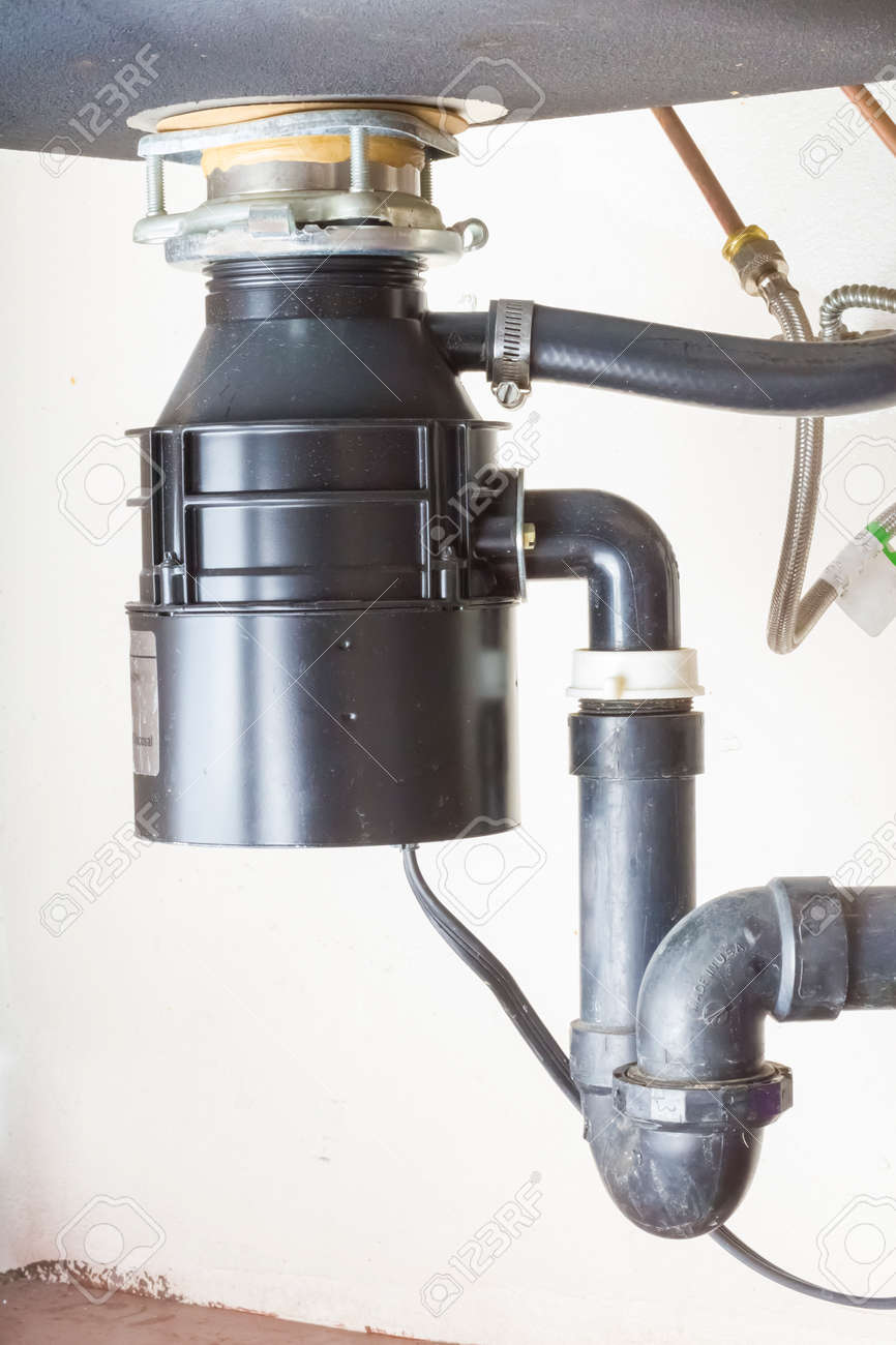 Under The Sink Garbage Disposal Unit. Stock Photo   24682608