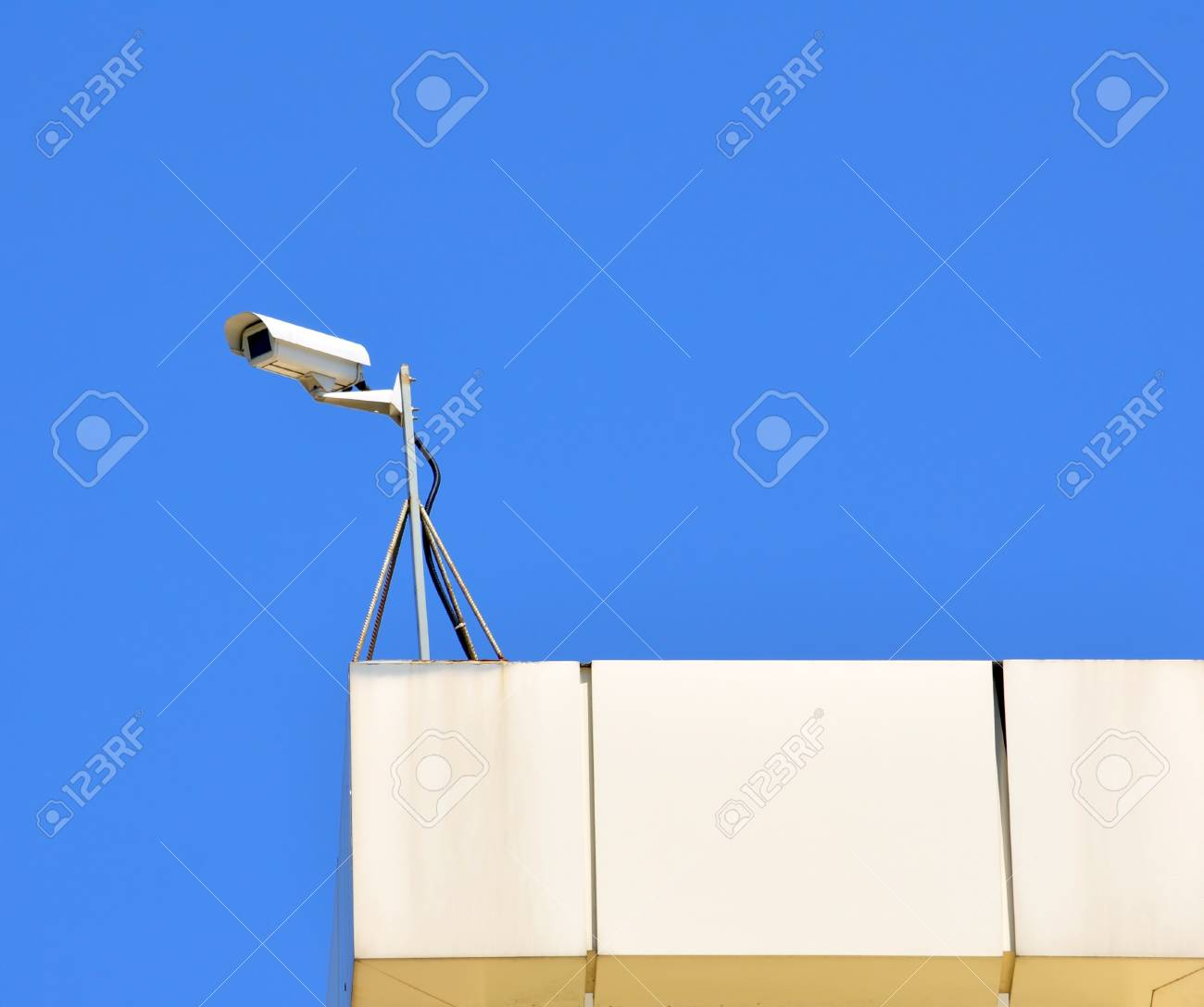 Surveillance cam on a roof watch left Stock Photo - 17398276