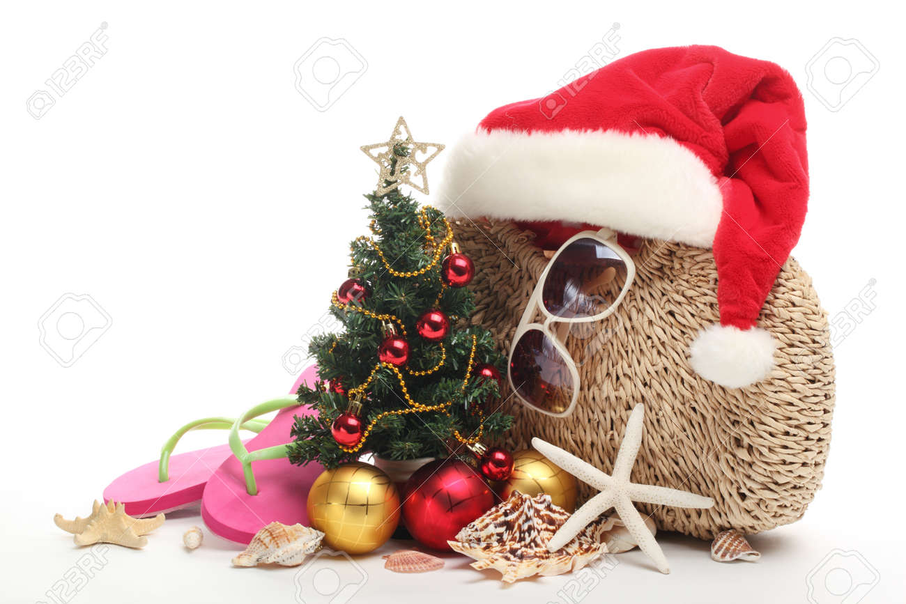 santa claus hat and christmas tree with beach accessories on white background stock photo - Christmas Tree Accessories