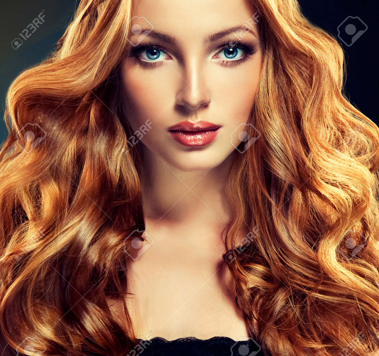 beautiful model with long curly red hair . styling hairstyles..