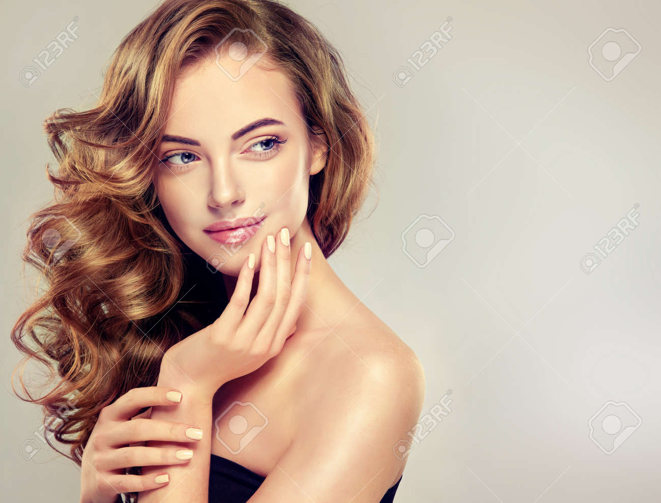 Beautiful Girl With Long Wavy Hair . Brunette Model With Curly Hairstyle  Stock Photo   53032293