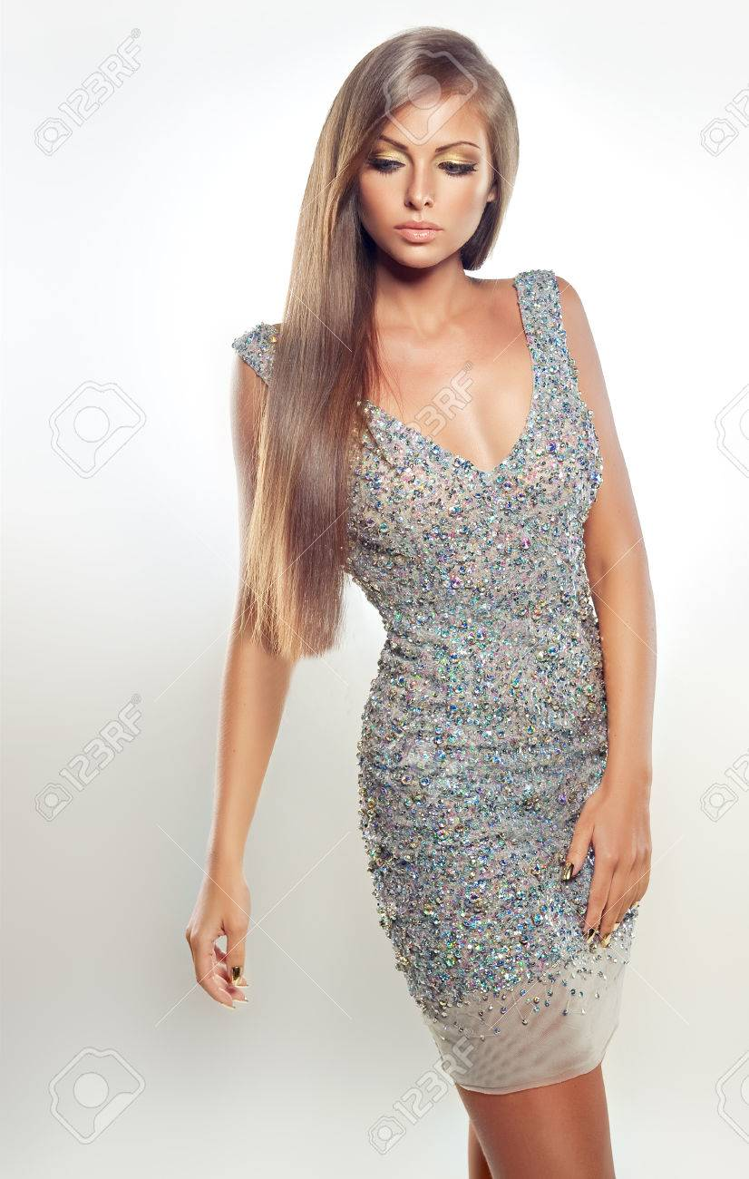 Portrait Of Fashion Model Dressed In A Silver Evening Gown ...