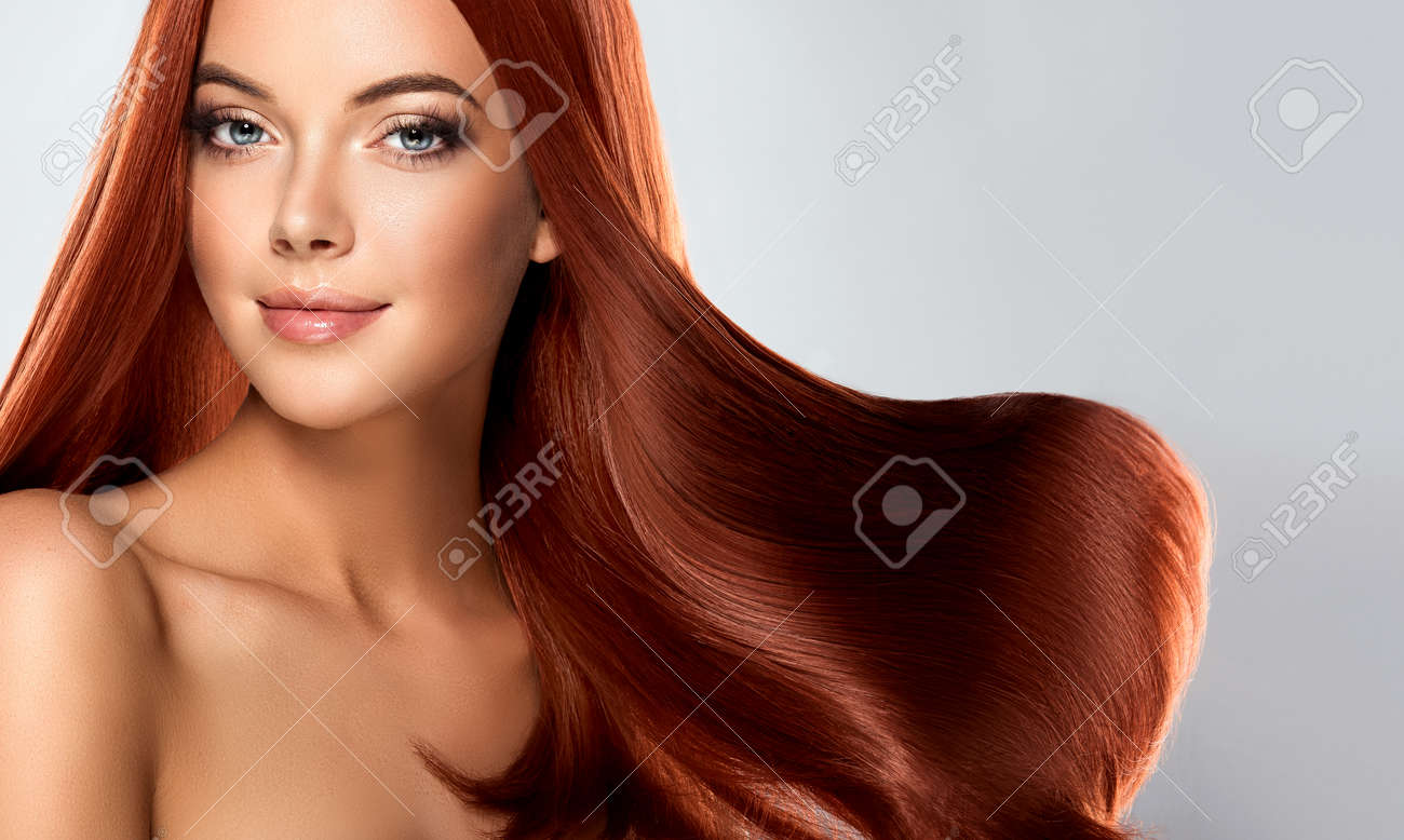 Beautiful Model Girl With Shiny Brown Straight Long Hair Care And