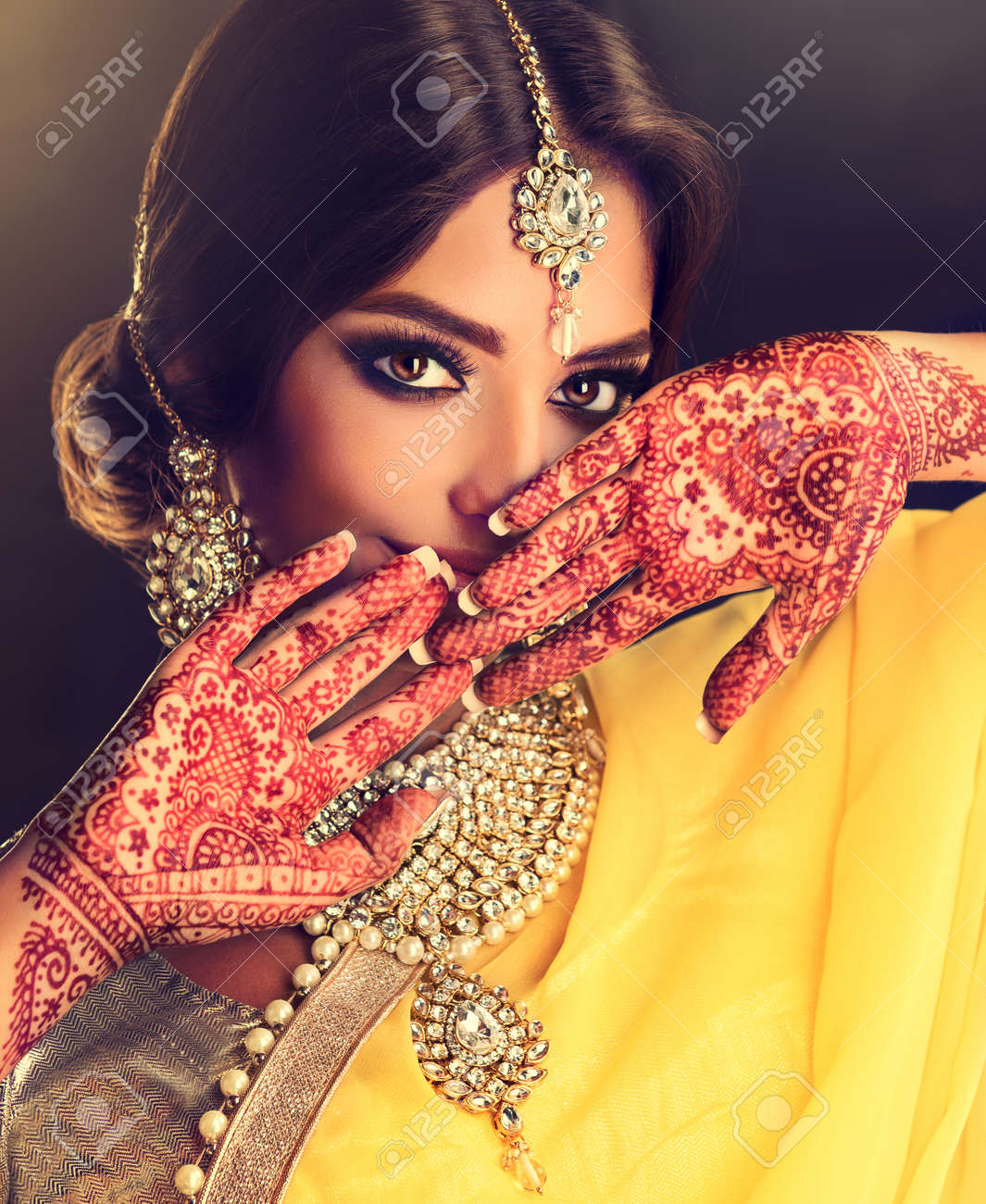 Beautiful indian girl . Young hindu woman model with tatoo mehndi..