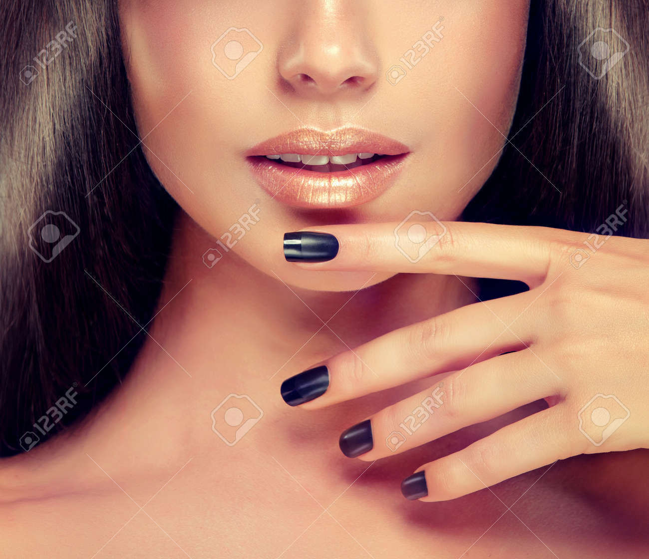 Beautiful woman-model is showing black french style manicure..