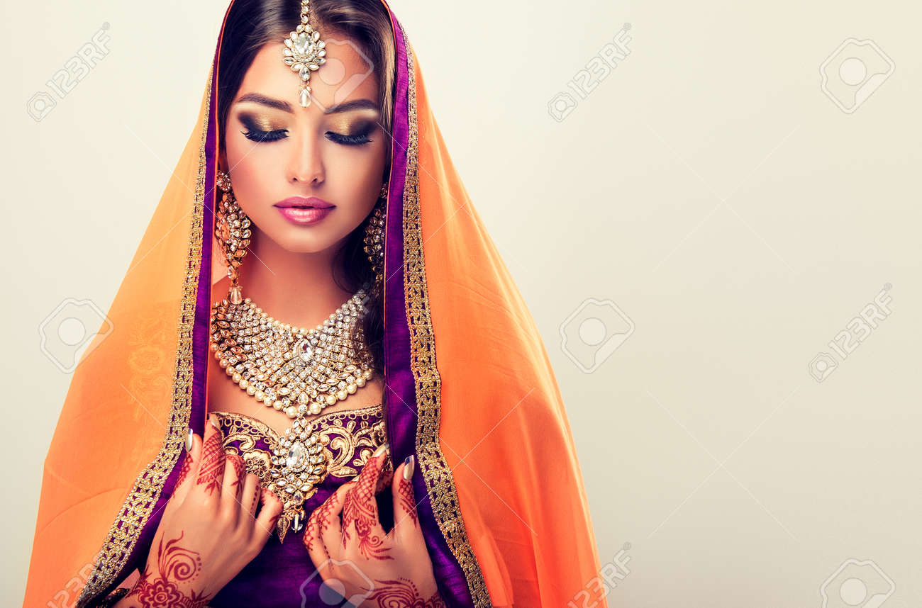 6fdafcbb6e Portrait of beautiful indian girl dressed in a traditional national  suit-sari, mehndi henna tattoo is painted on her hands and traditional  kundan style ...