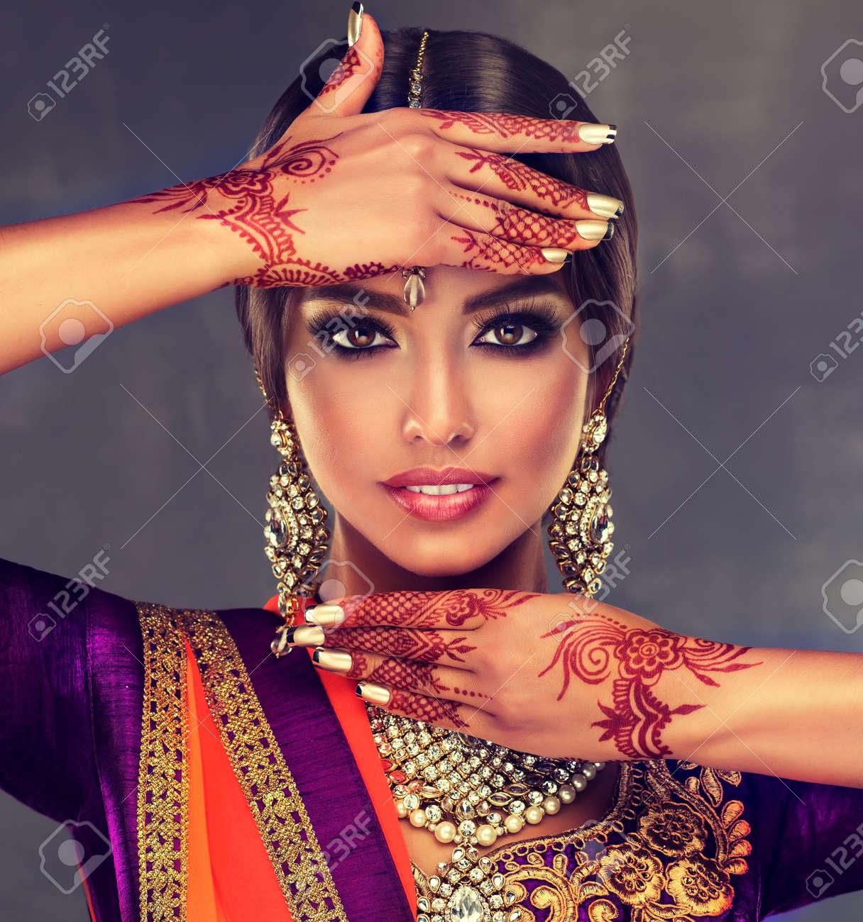 a308b72c1a Portrait of beautiful indian girl dressed in a traditional national suit  and mehndi tattoo is painted