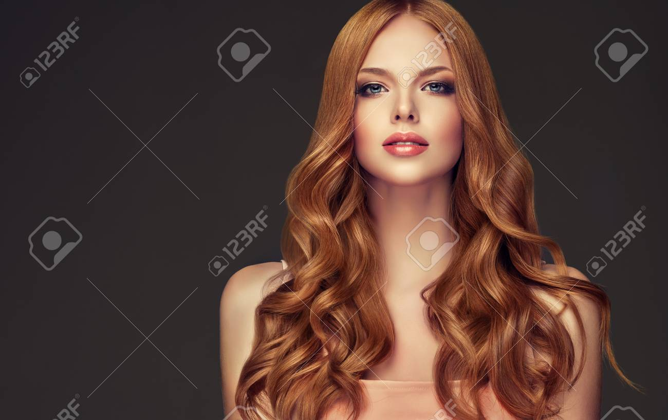 Young Red Haired Woman With Curly And Voluminous Hair Beautiful