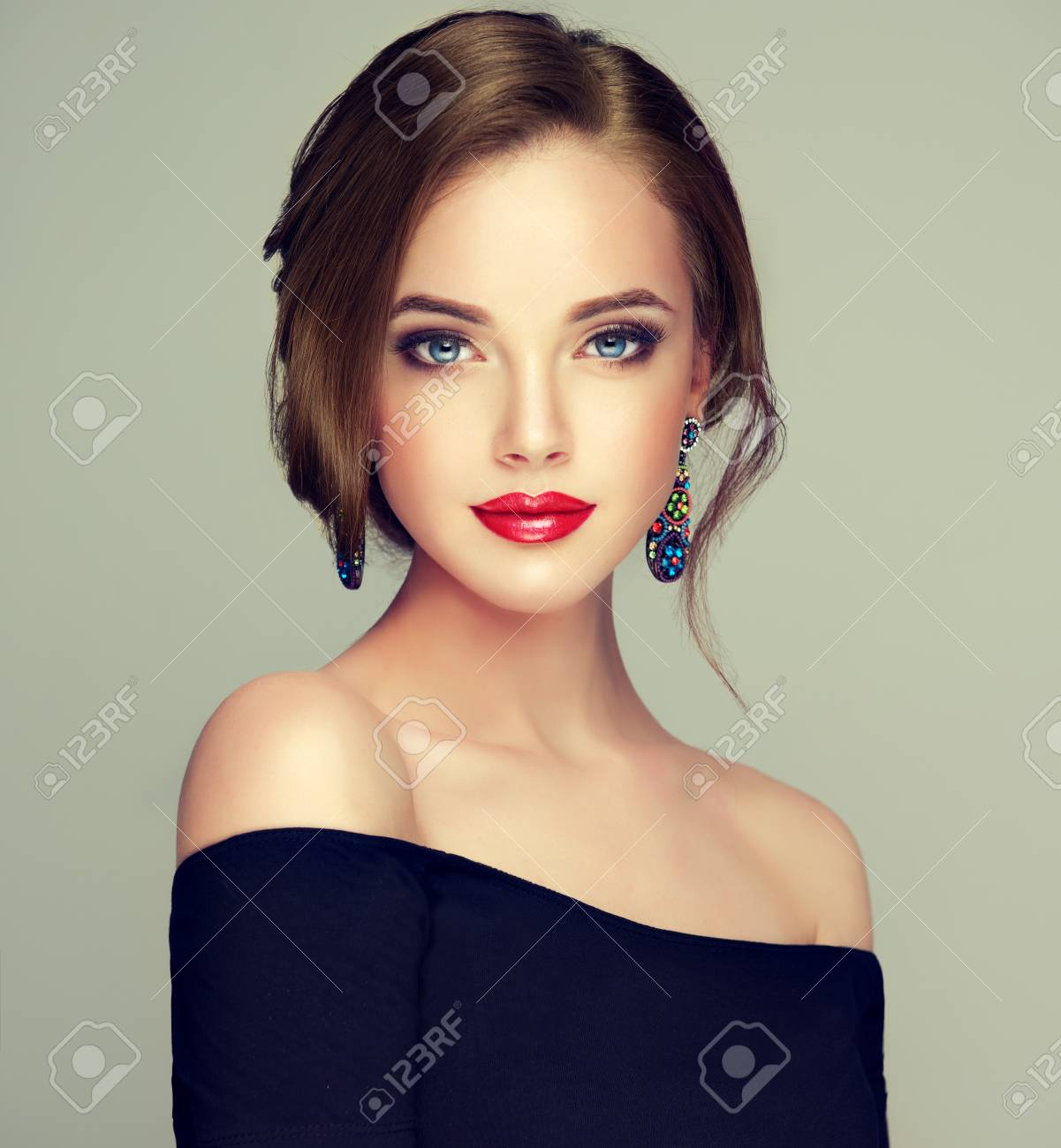 Portrait of young, brown haired beautiful woman with long, well groomed hair gathered in elegant evening hairstyle. Hairdressing art, hair care and beauty products. - 105387636