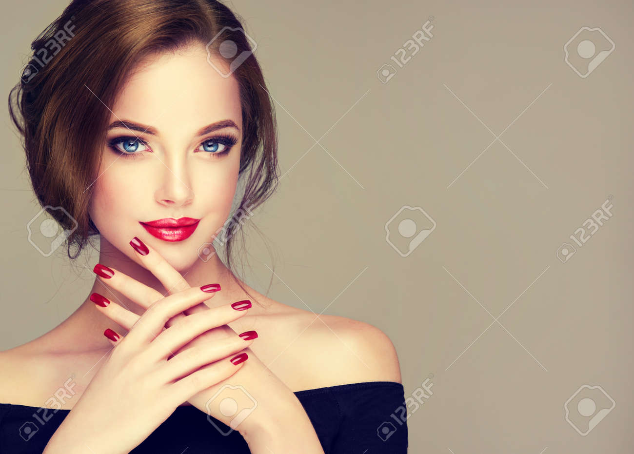 Portrait of young, brown haired beautiful woman with long, well groomed hair gathered in elegant evening hairstyle. Hairdressing art, hair care and beauty products. - 107197327