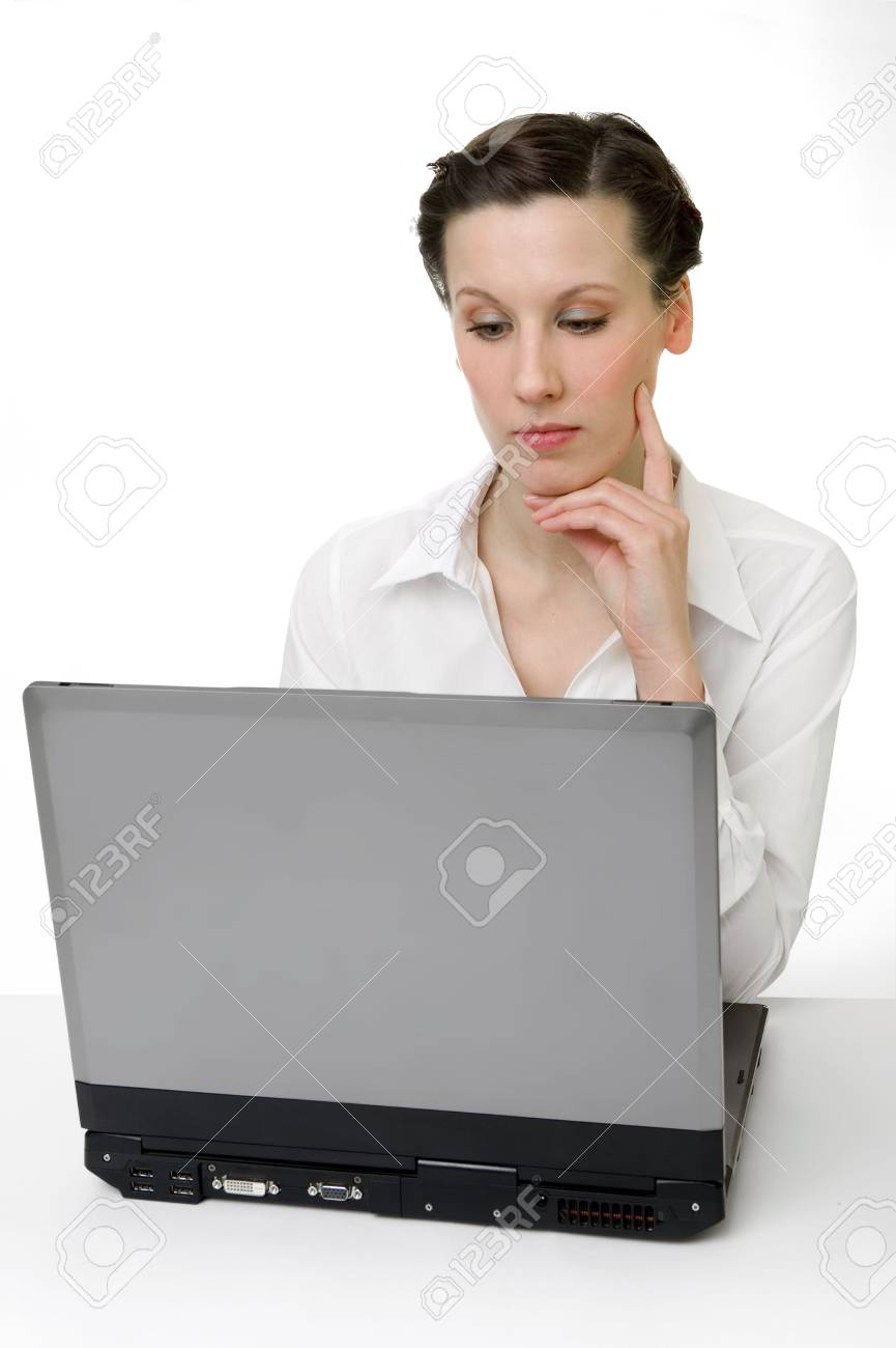 Portrait of an adorable business woman working at her desk with a laptop Stock Photo - 2319764