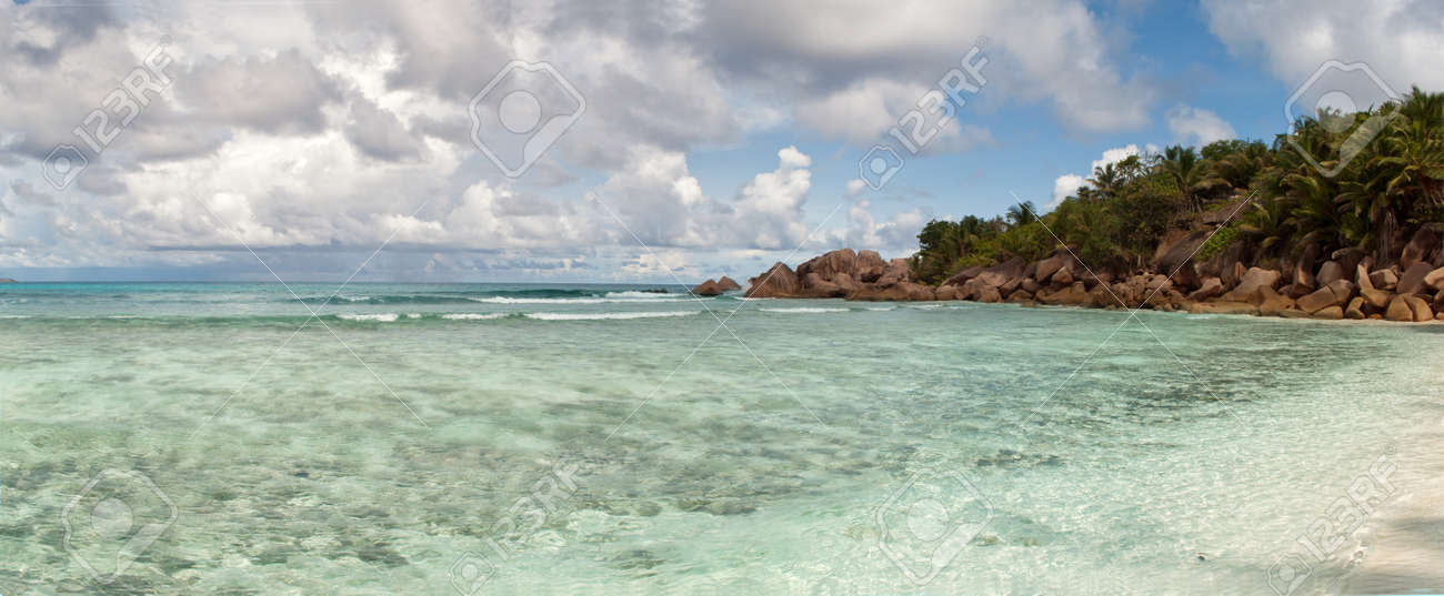 Beautiful tropical vacation in the warm sunny Seychelle island oceans and palm trees Stock Photo - 13531891