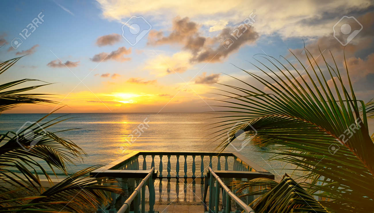 The view from the terraces of the beautiful sunset on the beach - 21965515