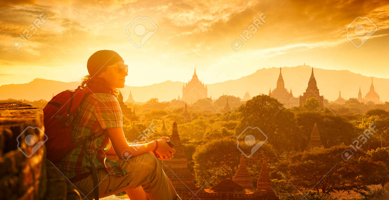 Young traveller enjoying a looking at sunset on Bagan, Myanmar Asia. 