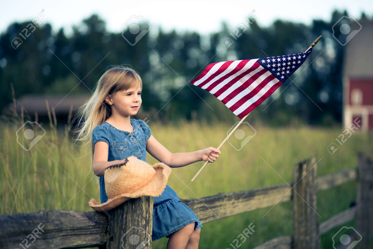 Little girl with American flag Stock Photo - 50129849