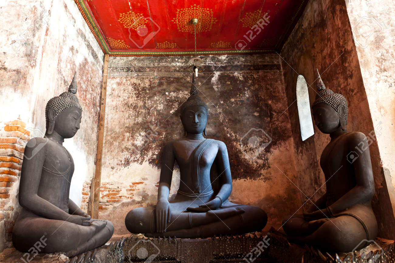 three black buddha against the ancient wall Stock Photo - 8552587