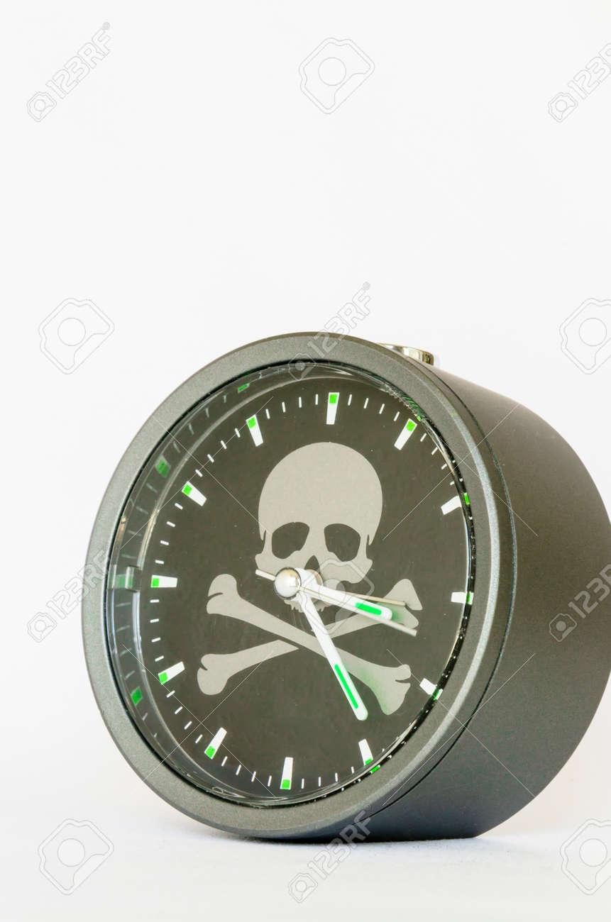 alarm clock with skull and bones on white background Stock Photo - 24636122
