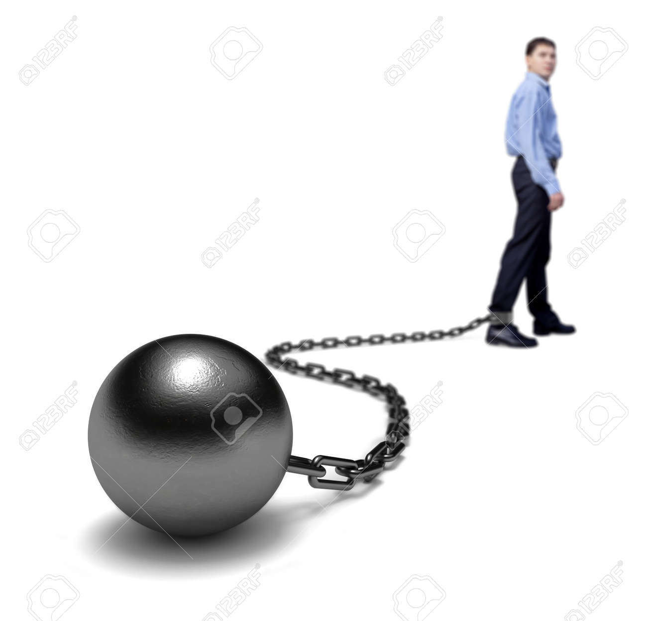 Man's legs dragging a ball and chain, selective focus. Stock Photo - 11902554