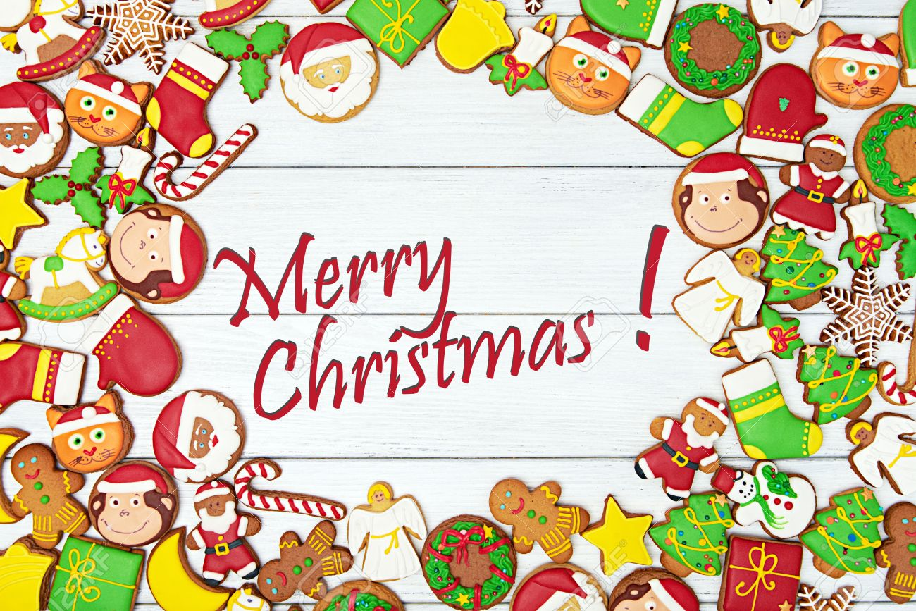 merry christmas card with variety of gingerbread cookies with