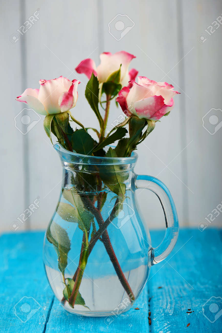 Three Pink Roses Floral Arrangement With Stems And Leaves In Stock Photo Picture And Royalty Free Image Image 53786780